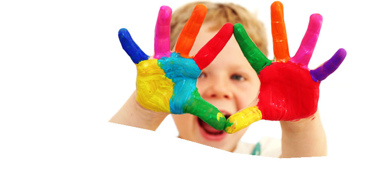 Boy with brightly painted hands